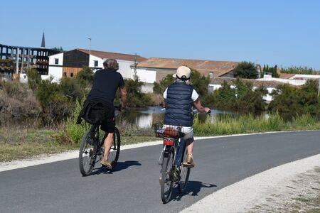 cyclists on a bike path on the island
