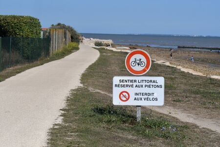 pedestrian path on the sea shore on the island of Re - France