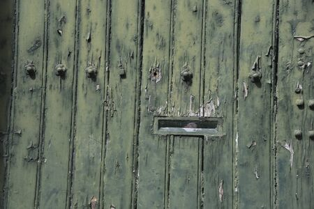 detail of a wooden door with mailbox Фото со стока
