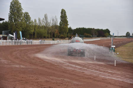 watering the racetrack track Stockfoto
