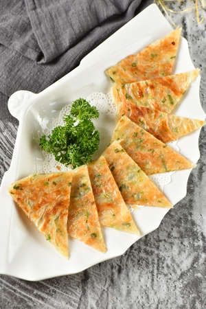 A plate of ried hand made scallion pancakes 스톡 콘텐츠