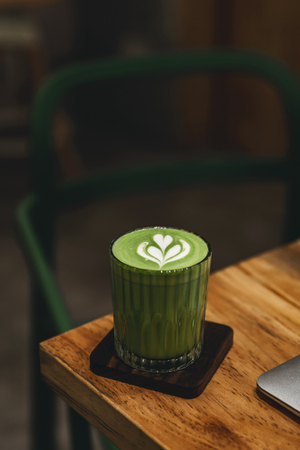 A cup of Matcha latte on the table