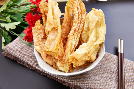 Fried bean curd stick in a white bowl