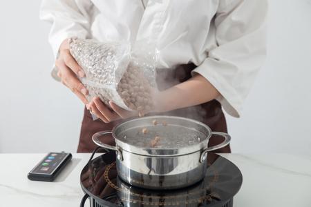 A man is making brown sugar pearl