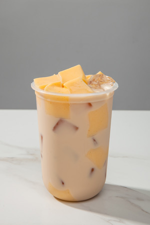 Milk tea pudding in a transparent glass Stock Photo