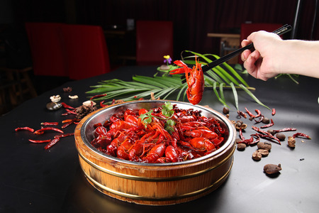 Spicy crayfish in wooden casks in a wood pot