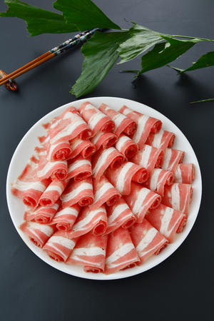 Fresh beef slices in a white dish Stock Photo