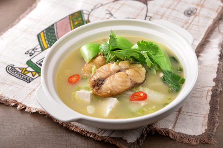 The fish soup in a white pot