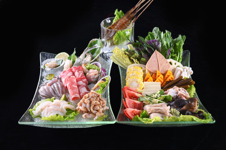 Seafood and fat beef slices hot pot set meal Фото со стока