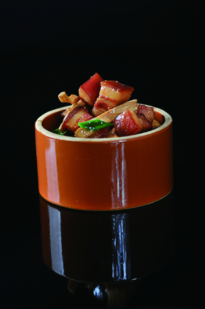Braise pork with soy sauce bamboo shoots in a ceramic pot
