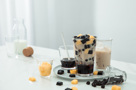 Grass jelly pudding pearl milk tea on table 免版税图像
