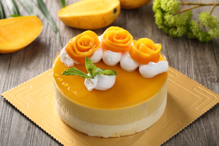 Mango cheese cake in a paper dish