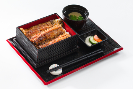 Grilled eel box meal in a black dish