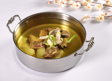 White radish beef bone clear soup hotpot Stock Photo