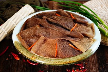 Fresh dark tripe slice in a ceramic dish