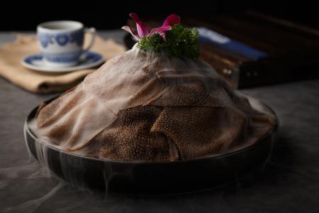 Fresh beef tripe in the black ceramic dish