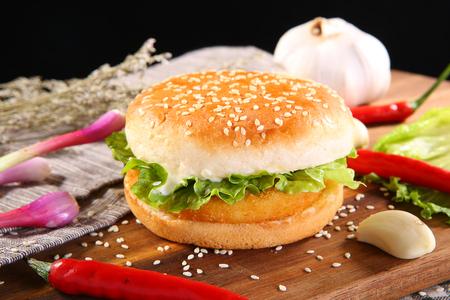 Chicken burger on a wooden dish