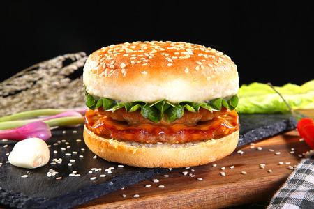 Double beef burger on a black stone slab Banco de Imagens