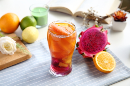 White peach oolong tea with fresh cut pitaya and orange