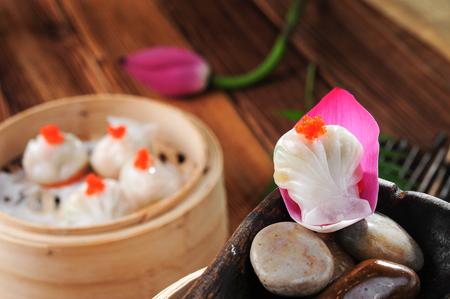 Crystal shrimp dumplings in a bamboo weaving dish Reklamní fotografie