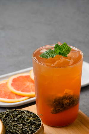 Grapefruit iced tea with mint leaf in a  glass Archivio Fotografico