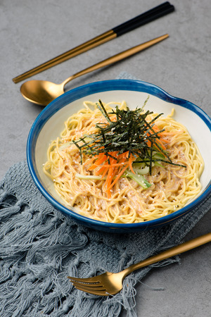 noodles with dried seaweed in a ceramic dish