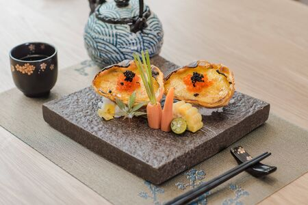 Grilled minced fish roe with garlic in Japanese style Archivio Fotografico