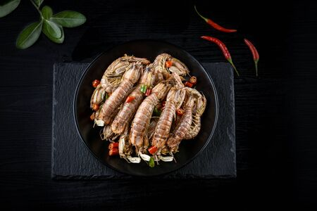 Pepper and salt mantis shrimps in the black background Archivio Fotografico