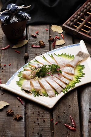 Fresh raw fish block in a white ceramic dish Archivio Fotografico