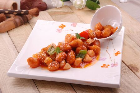 Pineapple sweet and sour in a white ceramic dish