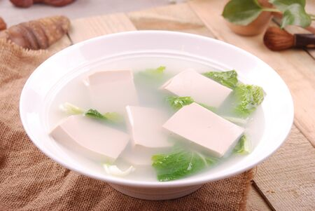 Vegetable soup in hot spring water in a white ceramic dish