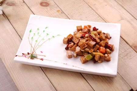 Kung chalcophora japonica gory in a white ceramic dish