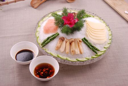 Cold sashimi platter with ice in a ceramic dish
