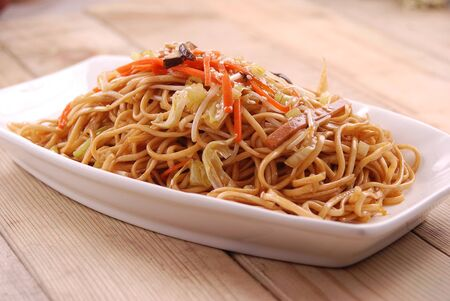 Fried noodles with three shredded ingredients in a white ceramic dish Archivio Fotografico