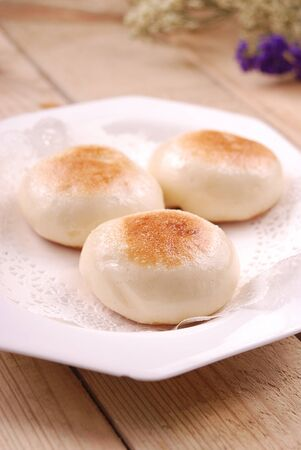 Handmade brown sugar fried bun in a white ceramic dish