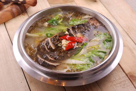Pickled cabbage fish with clear soup in a iron dish