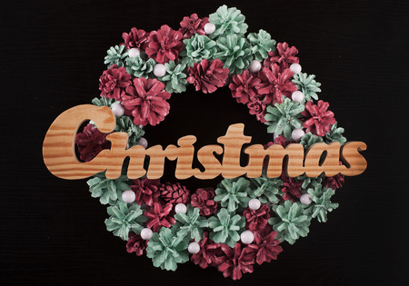 Christmas frame for greeting card with decorative wreath. black background photo