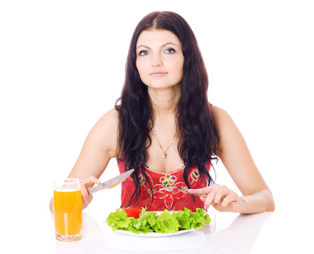 Woman with plate of salad and orange juice, isolated on white. photo