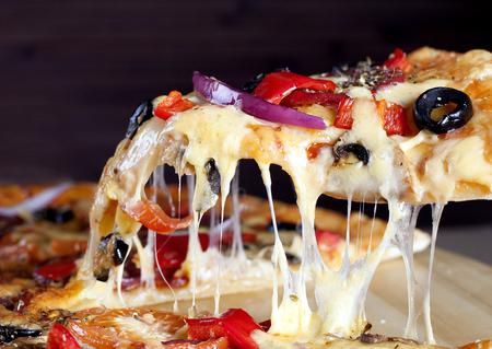 Slice of Delicious fresh Pepperoni Pizza.