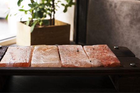 Himalayan pink salt. Salt plates. Bars of salt for cooking.