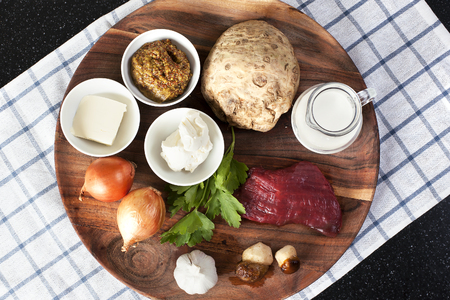beef stroganoff: Assorted raw ingredients for Beef Stroganoff with mashed potatoes or celery. Top view - Stock image