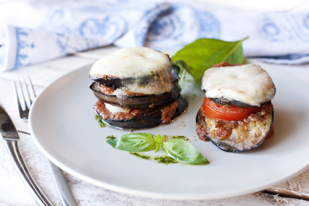 baked meat: Parmigiana di melanzane: baked eggplant - italy, sicily cousine. On the wooden table.