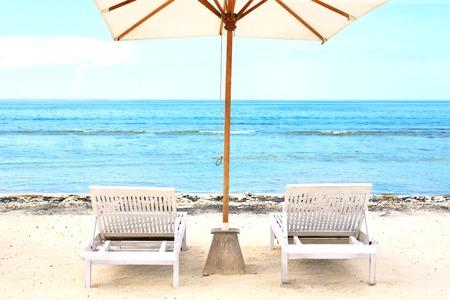 Beach Sun chairs on exotic tropical white sandy beach Stock Photo