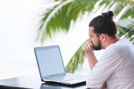 telecommuting: telecommuting, businessman relaxing on the beach with laptop and palm, freelancer workplace, dream job
