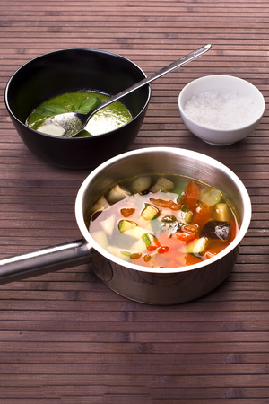 recipe decorated: Tuscan vegetable soup with basil pesto Stock Photo