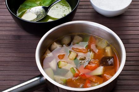 borlotti beans: Tuscan vegetable soup with basil pesto Stock Photo