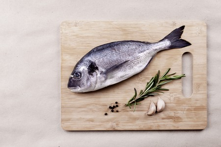 Fresh dorado fish seafood on wooden plank Stock Photo