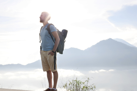 Hiker man with backpack enjoy with volcano Batur, Indonesia