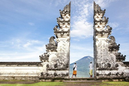 Indonesia - Bali - tourist standing betwen Lempuyang gate