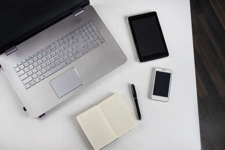 table with laptop and notebook Stock Photo